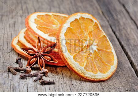 Dried Orange Fruit With Star Anise And Cloves On Wooden Table