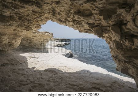 Cave. Rocks Near Governor's Beach, Cyprus Landscape