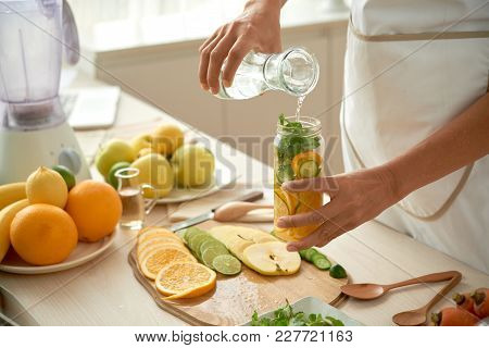 Cropped Image Of Woman Making Healthy Lemonade At Home