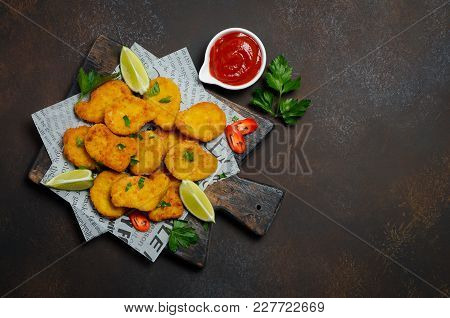 Crispy Fried Chicken Nuggets With Tomato Sauce On Dark Background Top View Flat Lay Copy Space