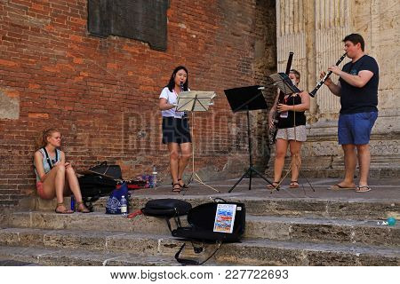 Montepulciano, Italy - July 19, 2017: Street Musicians In Tuscan Town Montepulciano, Tuscany, Italy