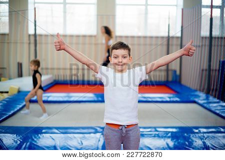 A Portrait Of Happy Kids In Trampoline Center