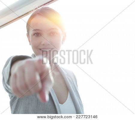 happy business woman pointing forward