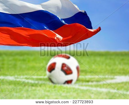 Blurred background of soccer ball, Russian flag in the focus