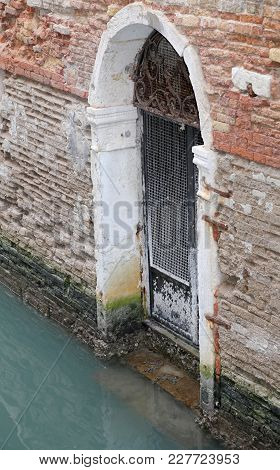 Old Venetian Gate With Low Tide In Venice Italy In Winter