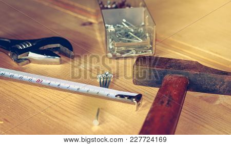 Hammer Nails Wrench And Meter Laid On A Wooden Stall