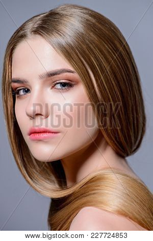 Beauty concept. Beautiful young woman with natural makeup and shiny healthy skin.