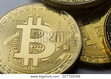 Golden Bitcoins On Us Dollars. Electronic Money Exchange Concept.