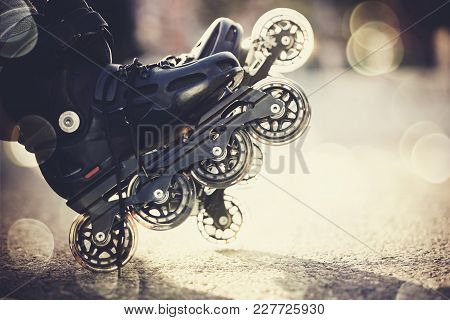 Background With The Roller Skates In The Rays Of The Sun.