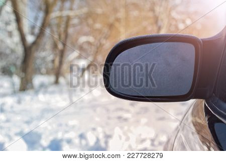 The Rear View Window Is Covered With Hoarfrost, Against A Background Of Soft Focus. Soft Background