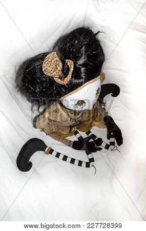 Creepy Steampunk Rag Doll Posed In A Sitting, Kneeling Position Looking Right, High Angle View. Life