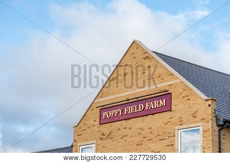 Northampton Uk January 15 2018: Poppy Field Farmhouse Inn Logo Sign Post In Duston.