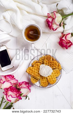 Morning Breakfast With Waffles, Tea And Ice Cream On A Bed , Homemade Food, With Roses And A Phone.