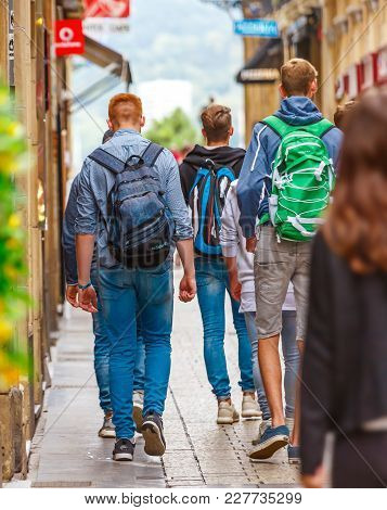 San Sebastian, Spain - September 27, 2016:group Of Students Coming Out Of School Walking On A Pedest