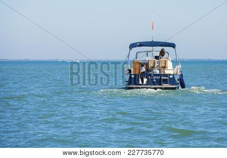 La Rochelle, France - August 22, 2016:pleasure Boat On The Sea Seen From Behind With A Passenger And