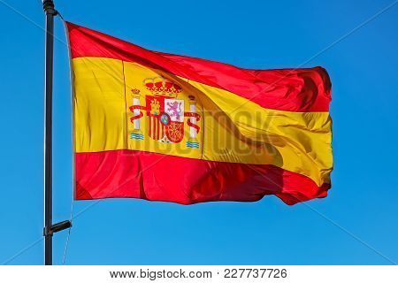 Spanish Flag On A Pole, Undulating In The Wind