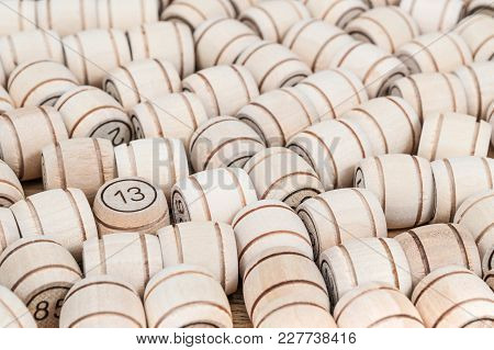 Pile Of Barrels Lying On The Table And The Number 13 Stands Out Among All