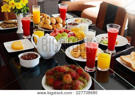 Healthy Breakfast With Bread And Sausage On Dark Wooden Table. Tropical Fruit, Fresh Pressed Juice,