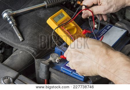 Measuring Voltage On Car Battery. Change Weak Battery