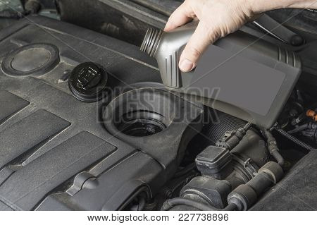 Add Up Oil To Car Engine From Bottle.