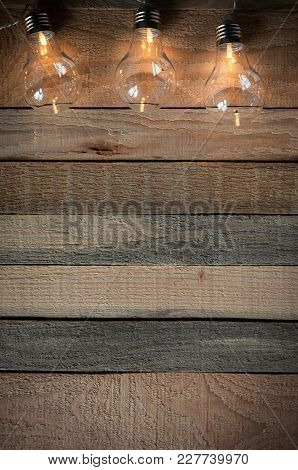 Top View Image With Bulblight Garland On Raw Rustic Background.