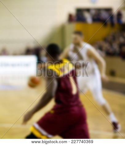 blurred basketball players