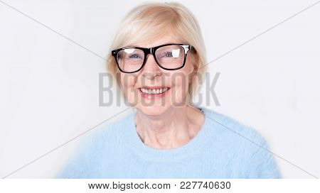 Portrait Of A Smiling Old Woman Wearing Glasses. Beautiful Modern Grandmother Is 70 Years Old - A Pe