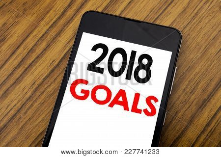 Word, Writing Handwriting 2018 Goals. Business Concept For New Yer Resolutions Written On Mobile Pho