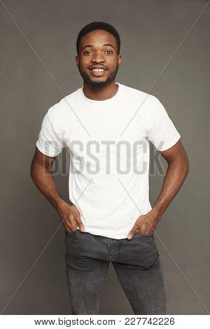 Happy Young Black Man Portrait In Casual At Grey Studio Background, Crop