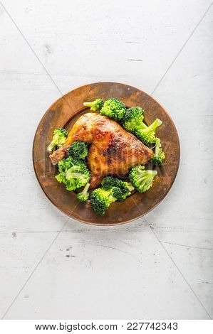 Roast Chicken Leg. Chicken Roasted Leg With Broccoli On Table