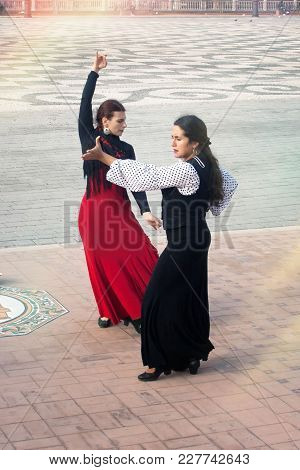Female Dancer Performing Flamenco For Tourists And Passers By In The Centre Of Seville. Spain, Sevil