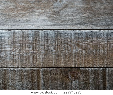 A Rustic Weathered Wooden Barn Board Background.