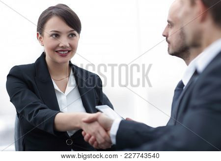 closeup of business woman shaking hands with her colleague.