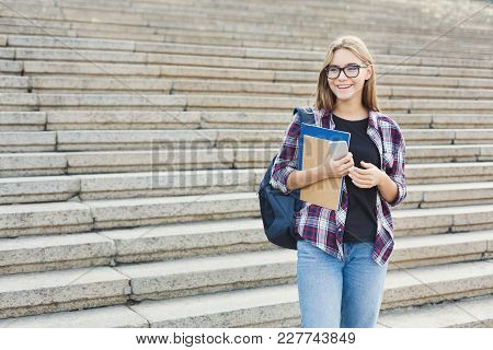 Attractive Kind Smiling Student Girl With Books On University Stairs Background, Looking Away, Dream