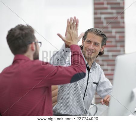 Businessman giving high five to his partner