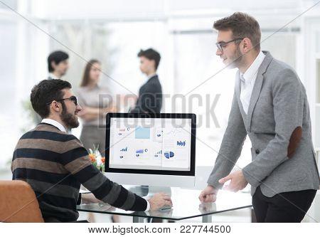 two businessmen analyzing stats financial data