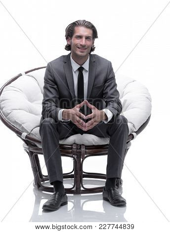businessman sitting in a comfortable big chair