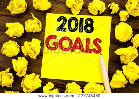 Writing Text Showing 2018 Goals. Business Concept For New Yer Resolutions Written On Sticky Note Pap