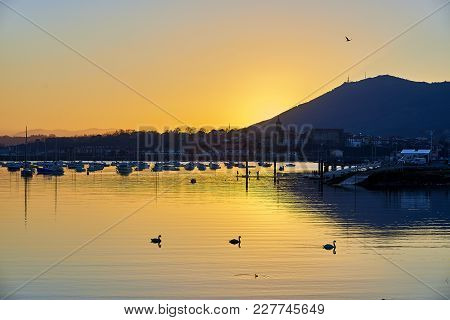Hondarribia (fuenterrabia) Skyline At Sunset With The Bay Of Txingudi In Foreground. View From Henda