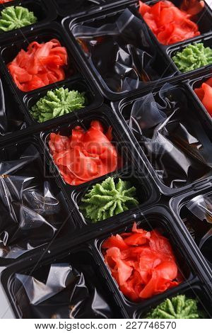 Japanese Food Delivery. Portions Of Ginger, Wasabi And Soy Sauce In Separate Chambers Of Black Take