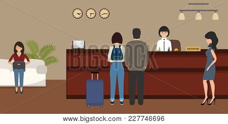 Hotel Reception. Young Woman Receptionist Stands At Reception Desk. There Are Also Visitors Here. Tr