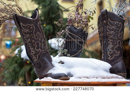 Ladies Vintage Leather Cowboy Shoes Covered With Snow.