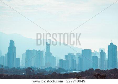 Benidorm Skyscrapers From Below In Foggy Day.