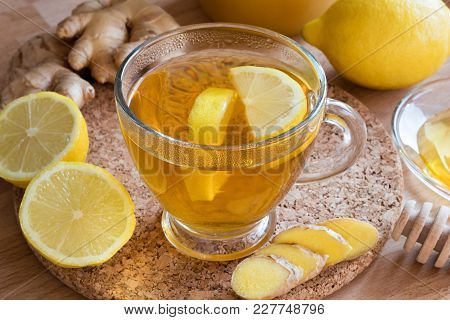 A Cup Of Tea With Fresh Ginger And Lemon