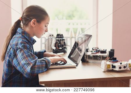 Creating Robotics Project, Mockup. Concentrated Girl Typing The Plan Of Innovation Robot Model In La