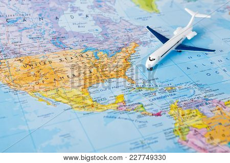 Travel To Europe By Plane Background. Plane On Map Closeup. Vacation And Business Trip Concept