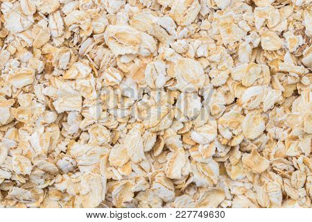 Texture Background Heap Of Rolled Oats. Closeup. Top View.
