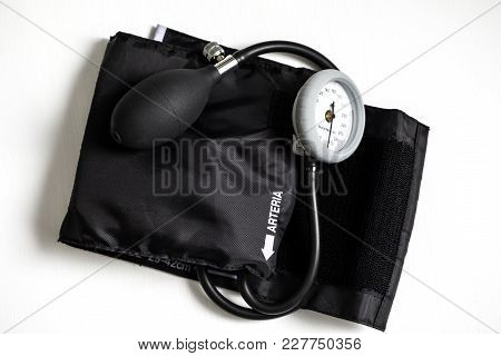 Blood Pressure Cuff For Medical Exams And Health Care On A White Background