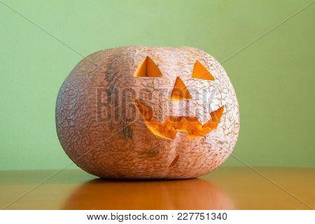 Halloween Pumpkin On Table Green Wall Background, Jack O'lantern