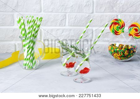 Coctail Party, Soda Drink Served With Rosemary And Berries, Jug With Striped Green Straws, Colored C